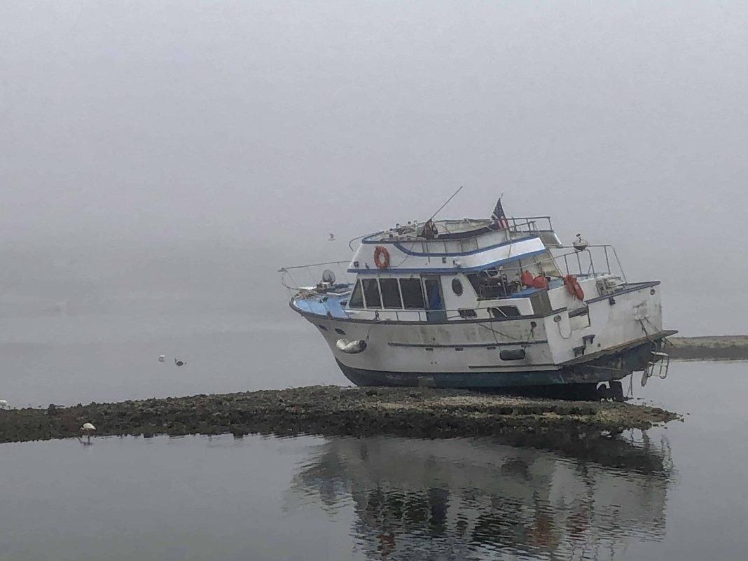 Stranded boat on Clam Bayou